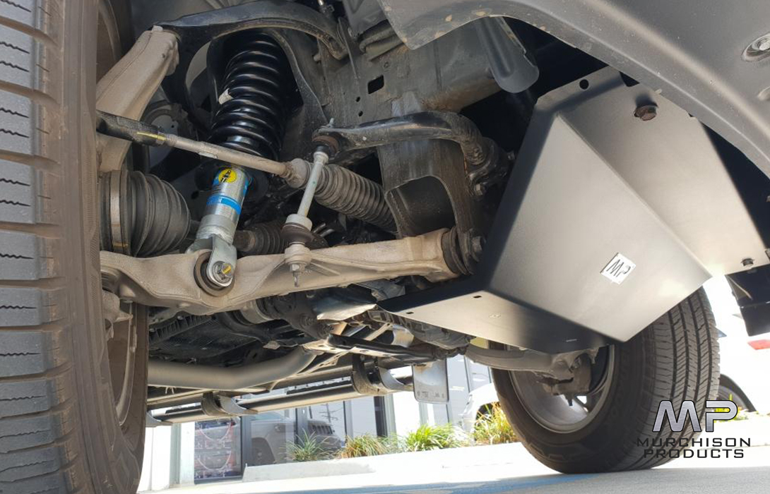 Murchison Ram 1500 Skid Plate - Side view showing skid plate side and vehicle suspension